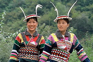 Two Baima women in traditional costume. Sichuan Province, China.