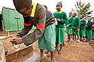 School girls filling water bottles at a water tap. Nairobi City, Kenya / ©: WWF-Canon / Martin HARVEY