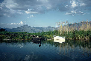 Fishing boats, wet meadows, and reeds. Prespa lakes, Greece.   	© WWF / Georgia VALLAORAS