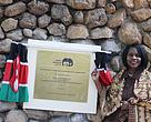 Cabinet Secretary for Environment and Natural Resources Prof. Judi Wakhungu unveils a plaque to officially open East and Central Africa's first forensic and genetic lab for wildlife.