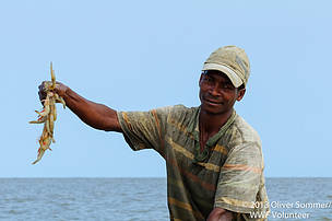 A fisherman with proud catch