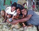 Turtle monitor Emosi Time to the right with student researchers on Kavewa island in Macuata