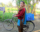 Padma Dhami with the bicycle that she has renovated with the support received from the Hariyo Ban Program.