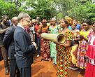 Local women in Mambele village near Lobeke National Park presenting gift to Ambassador Stell