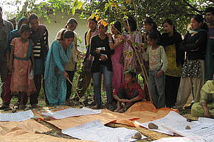 Villagers explain the results of participatory vulnerability assessment, Banke