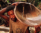 Solitary Gold-miners, 'garimpieros solteros' panning for gold in tropical rainforest in the Amazon.