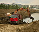 Excavators at work opening up the Mahmudia polders in the Danube Delta, Romania