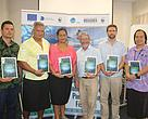 (L-R) WWF-Pacific's Duncan Williams, Toolkit Author, Dr. Desmond U Amosa, Pacific Islands Forum Secretariat's (PIFS) Katarina Atalifo, CSO Workshop facilitator, Ian Cartwright, FFA's David Power and PIFS Sai Too Go with their WWF-Pacific's Policy Analysis and Engagement Toolkits.