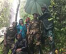 A tourist with rangers and local guides during the mountain expedition. Tourism is a catalyst for economic development through revenue sharing with adjacent communities