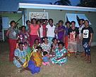 Women of Navotua and Natutu in the Yasawa's pose in front of their women's community kitchen.