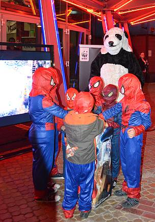 Kids dressed as Spiderman join the WWF panda for lights out on Earth Hour in Sofia, Bulgaria