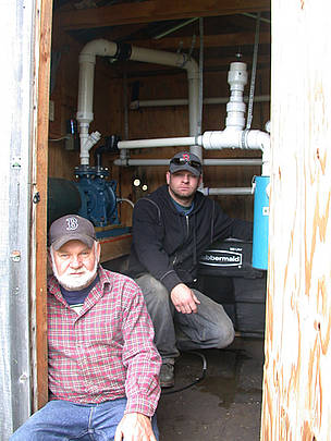 Burr Morse, Vermont maple syrup farmer, and his son Tom.