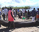 Waiting for fishermen to bring a day's catch to the shore on lake Malawi.