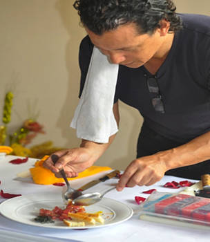 Chef Bobby Chinn giving a demonstration at an event aimed at raising awareness of the environmental impacts of seafood consumption.