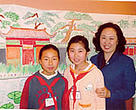 Math teacher Liu Furong (right) with students Guo Qian and Xiao Xiao.