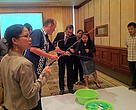Datuk Masidi Manjun, Minister of Tourism, Culture and Environment Sabah, trying his hand at a game to demonstrate sustainable fishing.