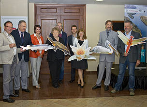 Danube partnership launch, holding props of Danube species