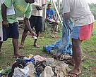 Dau ni Vonus collect debris from a beach. Plastic is notorious for blocking turtles' guts, as they mistake it for squid.