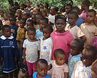 Mixed Baka and Bantu children in a school in the South East Cameroon, assemble for outdoor lessons
