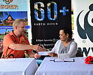 Uprising Beach Resort general manager James Pridgeon handing over $2,000 to WWF-Pacific Communications Manager Mary Rokonadravu to support Earth Hour Campaign