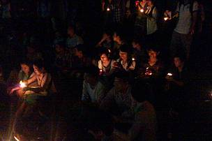 Students are lighting the candle during Earth Hour event