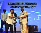 WWF Director for Africa Region Fredrick Kwame (left) presenting the Award to the Tourism and Conservation Winner Peter Nyanje