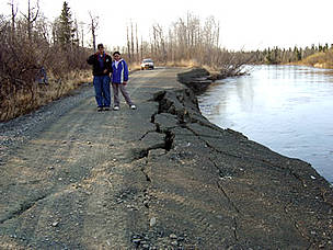 Riverbank erosion undermines a road. Unalakleet, Alaska.  	© Native Village of Unalakleet