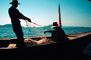 Fisherman Pullng nets Phang Nga Bay Thailand