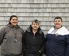 From left, three generations Lillionna Kosbruk, her grandmother Annie Christensen, and her mother Gerda Kosbruk. They are standing in front of one of the houses that was relocated from the old village of Meshik, Aljaska.