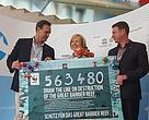 Representatives from WWF-Australia and WWF-Germany hand over Great Barrier Reef signatures to the UNESCO World Heritage Committee chair.