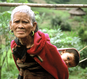 Tribal grandmother,  from the Ta Oi ethnic minority group, in Central Vietnam (Annamites), tends to ... / ©: WWF / Elizabeth KEMF