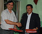 Dr K. C. Poudel, DG – Department of Forests and Mr. Anil Manandhar , CR – WWF Nepal shake hands after signing the grant agreement.