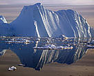 An iceberg calved from a glacier floats in the Jacobshavn fjord in southwest Greenland.