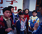An environmental education specialist talks to children in Lixian Hunan Province, China.
