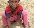 Kei Kecil boy with turtle eggs