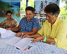 WWF-Pacific Representative Kesaia Tabunakawai with Marica Turaganivalu (center) of the Fiji Program Support Facility and Raziya Saiyed Finance Manager WWF-Pacific at the signing of the Emergency Preparedness  grant