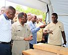 The guest of Honor Lindi RC Godfrey Zambi (in khaki shirt) receiving explanation of how the kiln works