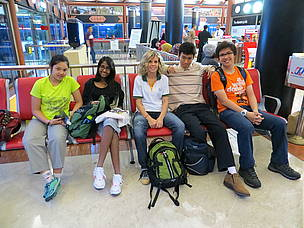 Students and teacher from the Australian International School at airport