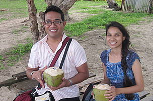 Enjoying a freshly sliced coconut with a colleague in a hot tropical summer of Vadra Vadra Village.