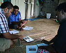 WWF-Pacific's coastal fisheries officer, Laitia Tamata meeting with a fishermen from Vanuakula village