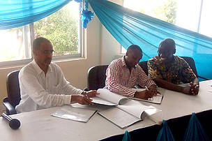 WWF-Kenya CEO, Mohamed Awer (left) and WWF-Kenya conservation Director, Dr. Jared Bosire (right) signing the MoU with KMFRI