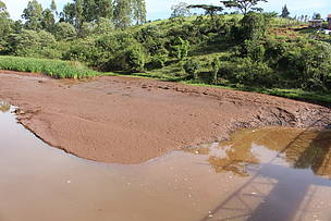 Heavy amounts of silt collect in a dam