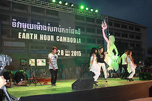 One of female Cambodian singer, Meas Soksophea singing and dancing at the Earth Hour Cambodia event