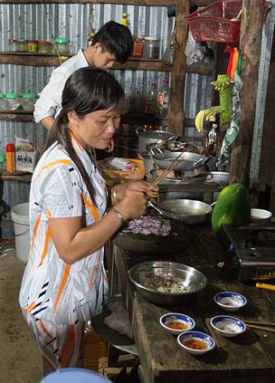 Mrs. Tran Thi Soi prepared meals for tourists staying at here homstay service in the mangroves of Mui Ca Mau National Park