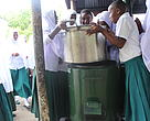 Students enjoying the cooker after receiving it