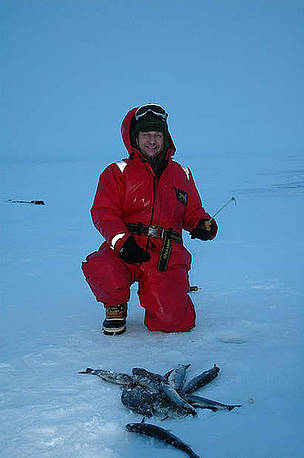 Tom Arnbom and the catch of the day - arctic char. Chukotka, Russia.      © Viktor Nikiforov