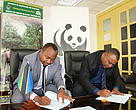 WWF Tanzania Country Director Dr. Amani Ngusaru (Right) and Tanzania Forest Service CEO Prof. Dos Santos Silayo (Left) Signing ToRs for DNSP