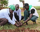Geoffrey Walker was joined by community members of Kakira in planting of tree seedlings at Mutai Primary School.