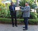 Iddi Hamis (Winner Africa Youth Award) receiving his award from WWF Tanzania Country Director Dr. Amani Ngusaru (L)