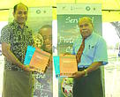 "WWF-Pacific Conservation Director Francis Areki with the President of the Fiji Council of Churches Rev Dr Tevita Bainivanua with the Englisn and I-Taukei version of the publication ""Christian Environmentalism:An Ecotheological approach to Earth keeping."""
